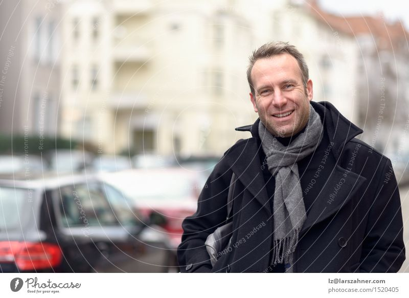 Young handsome confident fashionable man standing in an urban street Happy Face Calm Winter Masculine Man Adults 1 Human being 30 - 45 years Street Fashion