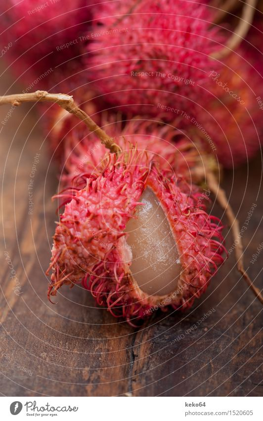 fresh tropical rambutan fruits over rustic wood table Fruit Dessert Nutrition Exotic Group Nature Plant Fresh Delicious Natural Juicy Red White Rambutan food
