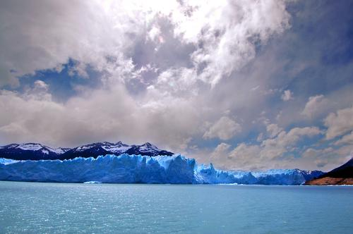 Perito Moreno Glacier in Patagonia (Argentina) Sky Nature Vacation & Travel Blue Ocean Landscape Clouds Winter Mountain Snow Rock Park River South Ecological