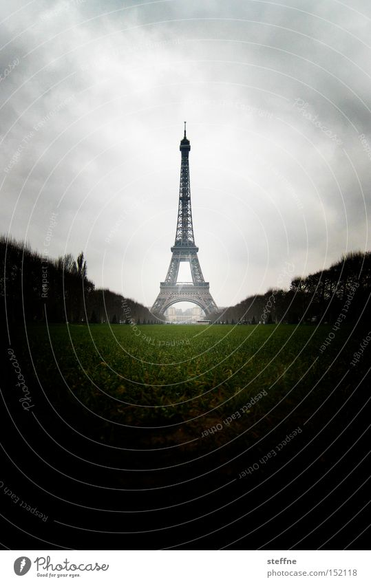 Le Christmas Tree Paris France Eiffel Tower World exposition Clouds Dark Threat Impressive Landmark Symbols and metaphors Tourist Tourist Attraction Monument