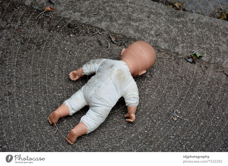 Baby doll face down in the street Toys Doll Bizarre Street Photography Stock fake Colour photo Exterior shot Deserted Morning Dawn Day Full-length Rear view