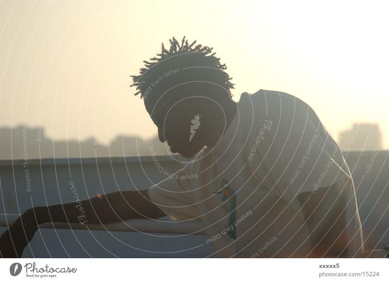 Rastaman Back-light Africa Dreadlocks Relaxation Evening sun Man Contentment