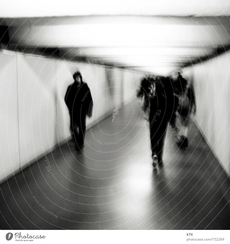 rabbit in your headlights Corridor Human being Going Tunnel Light Walking Anonymous Loneliness Skylight Claustrophobia Group Fear Panic Exclusion