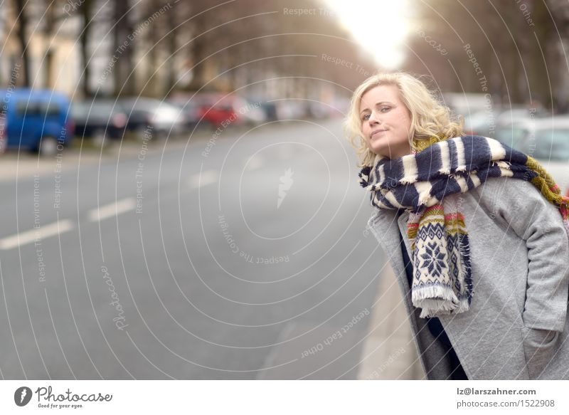 Blond woman waiting for a cab or a bus Human being Woman Winter Adults Street Fashion Copy Space Blonde Wait Alley Motor vehicle Conceptual design Scarf Lift 30 - 45 years Impatience