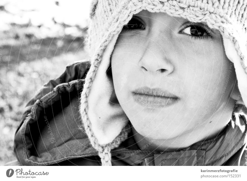 eye view Cap Winter Cold Black & white photo Face Portrait photograph Mouth Timidity Fear Child Boy (child) Snow Eyes Nose Lips