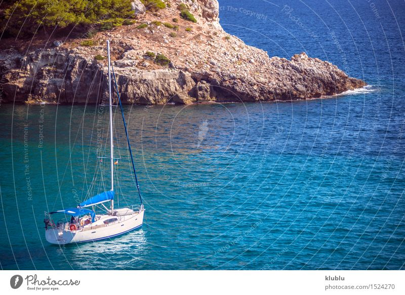 Blue sea and ship in Menorca, Spain Beautiful Vacation & Travel Tourism Summer Sun Beach Ocean Island Nature Landscape Sand Sky Tree Rock Coast Green Turquoise