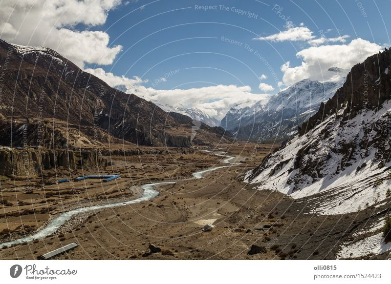View of Valley at Manang Village on the Annapurna Circuit Vacation & Travel Tourism Adventure Mountain Hiking Nature Landscape Clouds Snowcapped peak Glacier