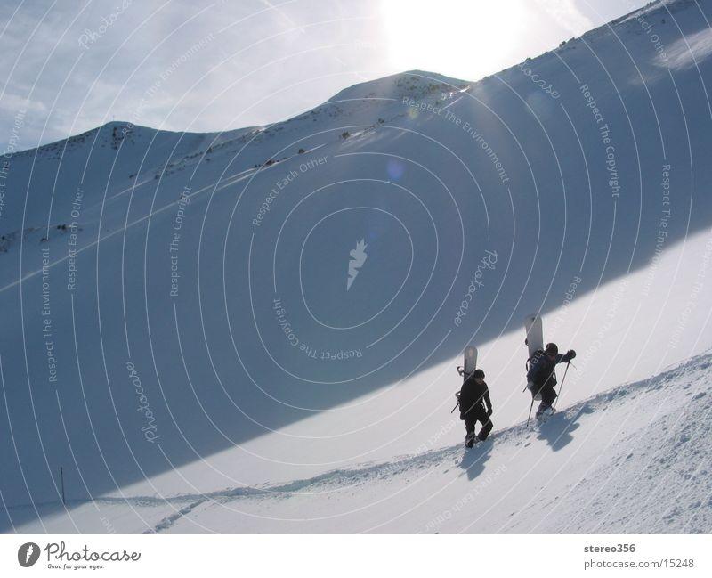 Sun on your neck Ski tour Mountain hiking snowshoeing Alps Snow mountain idyll