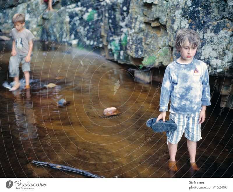 Child Water Summer Emotions Boy (child) Stone Think Rock Infancy River Concentrate Discover Brook Experience Love of nature Experiencing nature