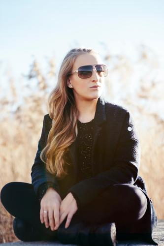 Getting the sun again Lifestyle Elegant Style Young woman Youth (Young adults) Nature Landscape Autumn Beautiful weather Common Reed Fashion Coat Sunglasses