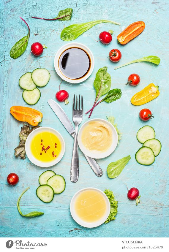 Cutlery with salad and dressing ingredients Food Vegetable Lettuce Salad Herbs and spices Cooking oil Nutrition Lunch Dinner Buffet Brunch Banquet Picnic