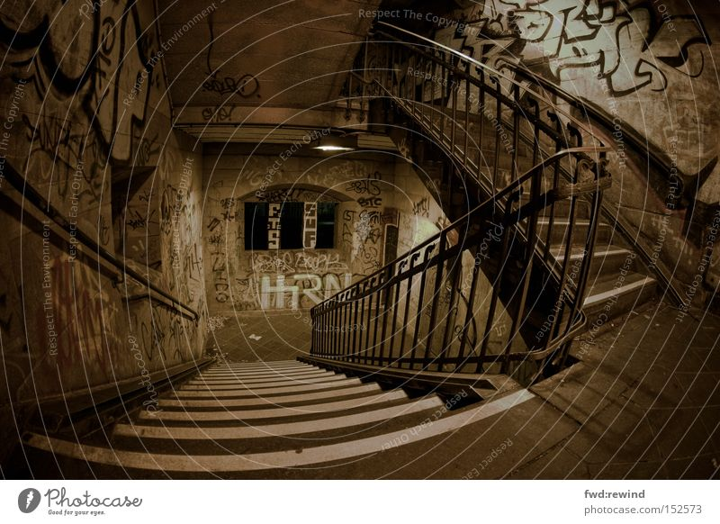 urban landscape Town Subsoil Staircase (Hallway) Stairs Ambiguous Fear Oppressive Night Banister Graffiti Loneliness Hiding place Crime scene Room Location