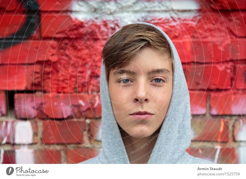 Portrait of a teenager with hoodie, in front of a red brick wall Lifestyle Style Design pretty Harmonious Well-being Contentment Human being Masculine Young man