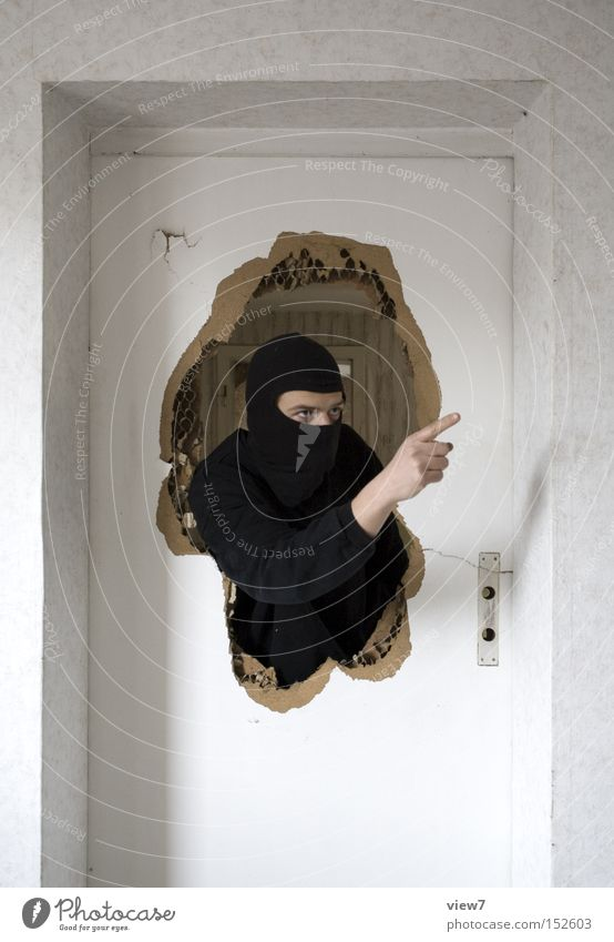 gestures Moving (to change residence) Interior design To talk Masculine Man Adults Life Arm 1 Human being Door Mask Cap Helmet Sign Aggression Anger Aggravation