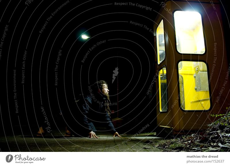 LIGHT BOX II Night Dark Black Phone box Yellow To talk Communicate Telecommunications Lamp Bright Light Man Observe Crouch Wait Attract Looking
