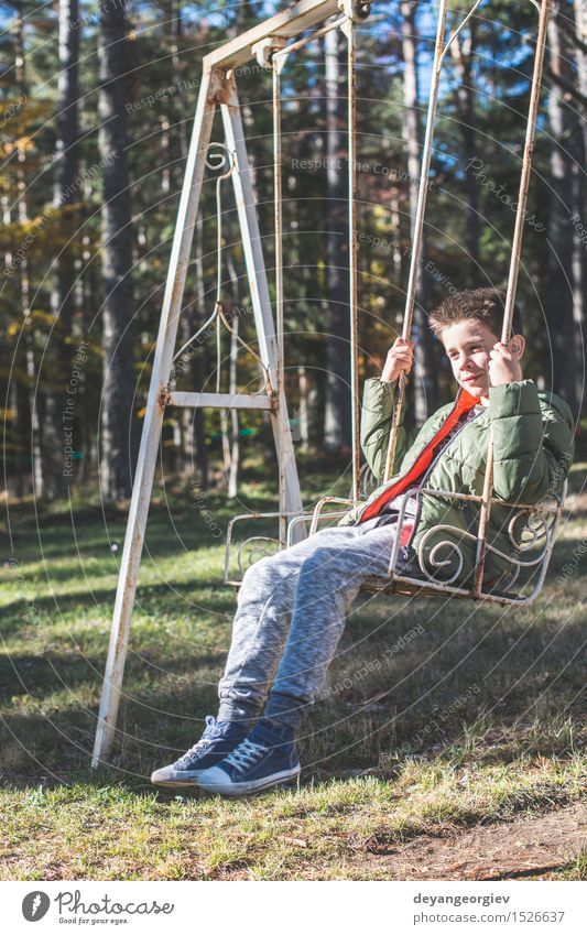 Child on a swing Joy Happy Leisure and hobbies Playing Summer Boy (child) Infancy Nature Tree Park Forest Smiling To swing Happiness Small vintage kid young