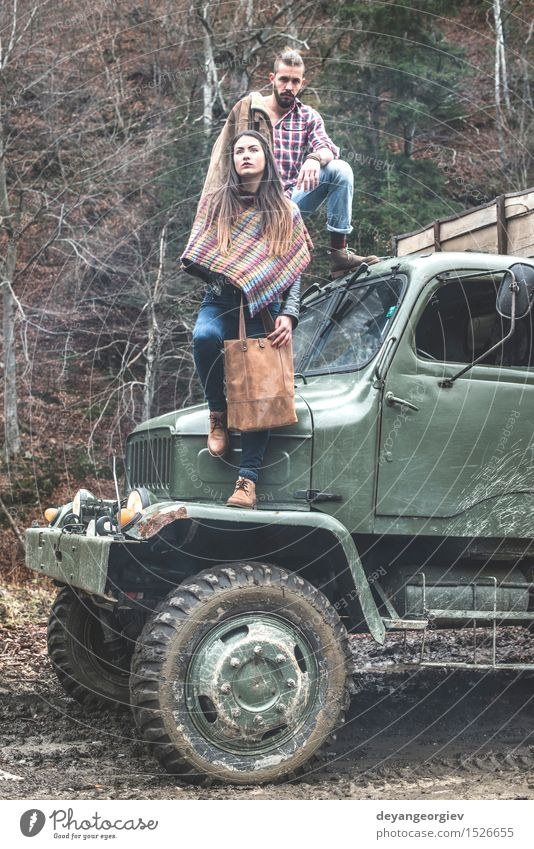 Young man and girl on truck Lifestyle Vacation & Travel Trip Adventure Woman Adults Man Couple Forest Car Fashion Leather Hat Beard Old Log people pick young