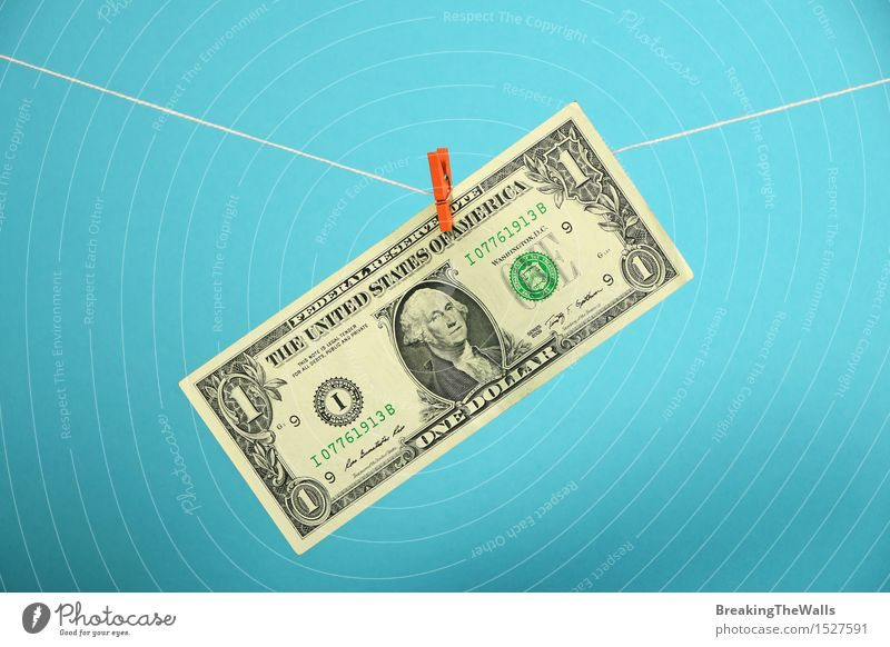 One dollar banknote hanged with pin at rope over blue Money Economy Trade Financial Industry Rope Stationery Hang Growth Strong Blue Dollar USA American up