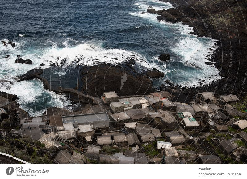 built close to the water Nature Landscape Water Rock Waves Coast Ocean Village Fishing village Deserted House (Residential Structure) Hut Wall (barrier)