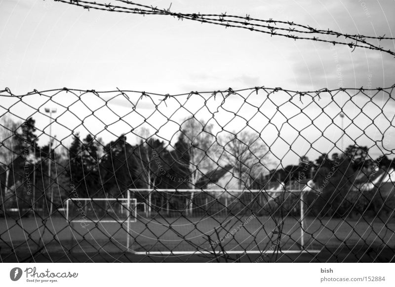 Dark Sports Autumn Playing Soccer Closed Fence Goal Floodlight Barbed wire Black & white photo Wire netting fence Erlangen