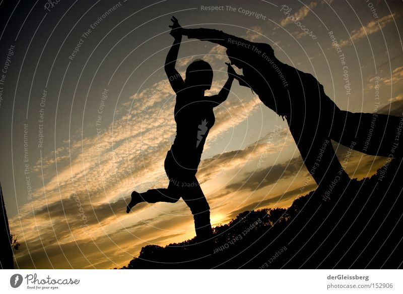 equilibrium moments Dance Back-light Sunset Light Contentment Calm Touch Black Yellow Sky Trust Concentrate Funsport Slacklining Exterior shot Balance Together