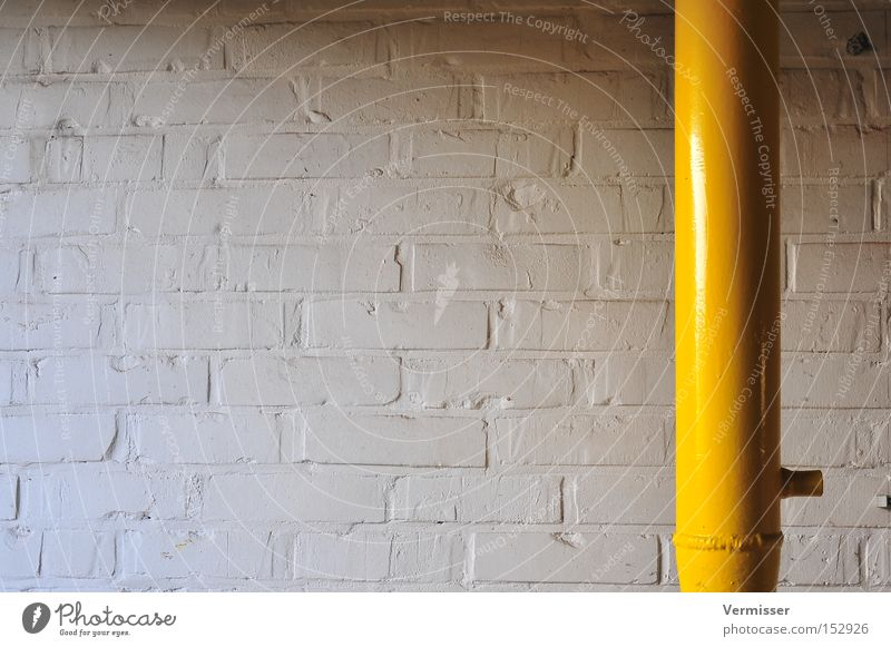 Breakthrough. Wall (building) Stone Colour White Yellow Iron-pipe Metal Light Shadow Structures and shapes Loneliness Industry