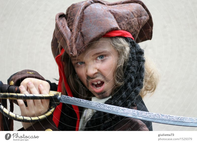 Ready to attack! | Boy in pirate costume Carnival Child Boy (child) 1 Human being 3 - 8 years Infancy 8 - 13 years Actor Hat Long-haired Curl Fight Scream