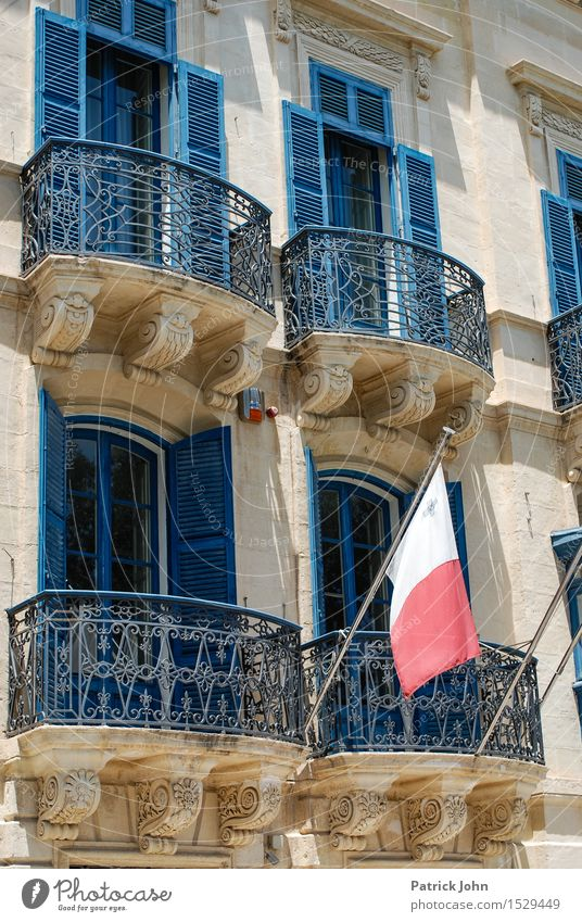 Vacation & Travel Sun Far-off places Window Architecture Building Facade Tourism Island Trip Europe Sign Discover Flag Balcony Capital city