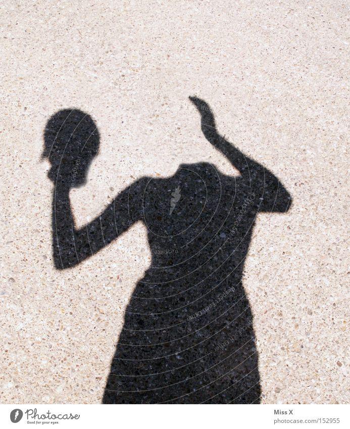 headless Colour photo Black & white photo Exterior shot Shadow Silhouette Woman Adults Head Hand Street Lanes & trails Crazy Whimsical Shadow play Headless