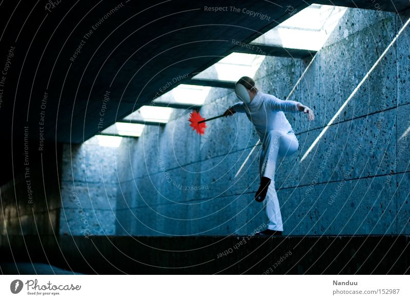 You could jump, but you don't have to. Human being Mask Stand Stork Underpass Tunnel Beam of light Contentment Balance Blue Subsoil Wait Whimsical Dance Ballet