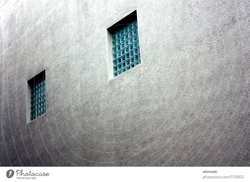 House wall with eyes Wall (building) House (Residential Structure) Window Concrete Glass block Facade Grating Penitentiary Captured Gloomy Entertainment