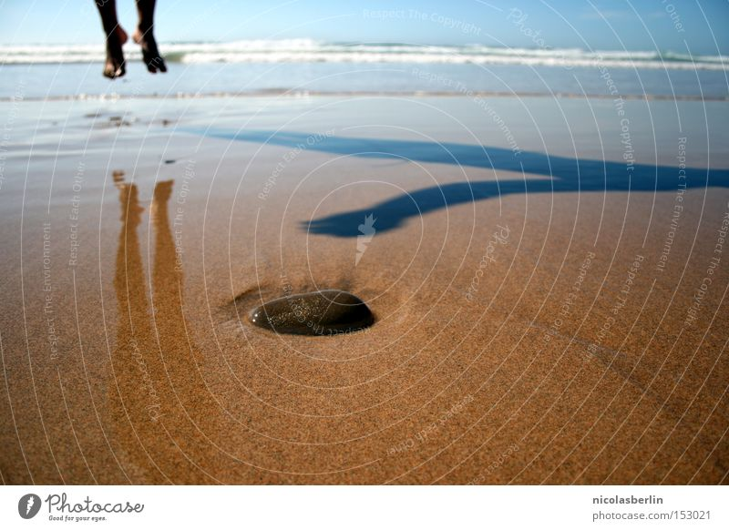 Take off in the New Year Beach Ocean Sand Stone Waves Portugal Wet Shadow Happiness Summer 2009 Joy Transience Feet