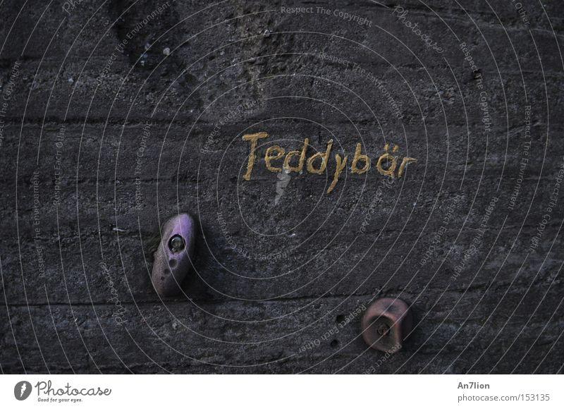 teddy bear Teddy bear Wall (barrier) Word Letters (alphabet) Gray Ochre Climbing wall Duisburg Characters
