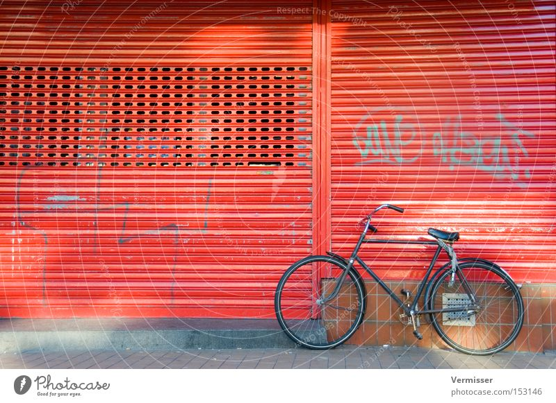 Fiets, he's sleeping. Bicycle Parking Red Black Metal Facade Sidewalk Graffiti Light Shadow Disk Slat blinds Netherlands Traffic infrastructure Beautiful Winter