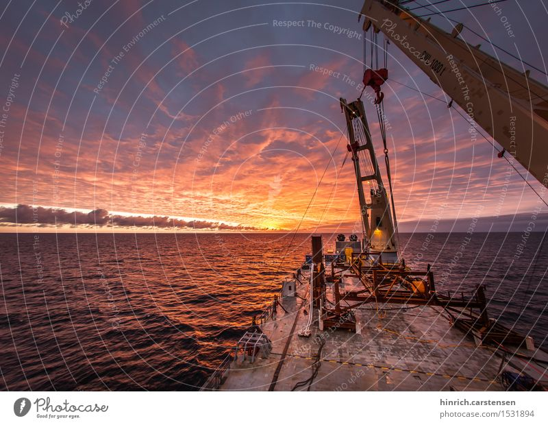 offshore Construction site Energy industry Technology Renewable energy Wind energy plant Water Clouds Sunrise Sunset Waves North Sea Ocean Navigation Watercraft