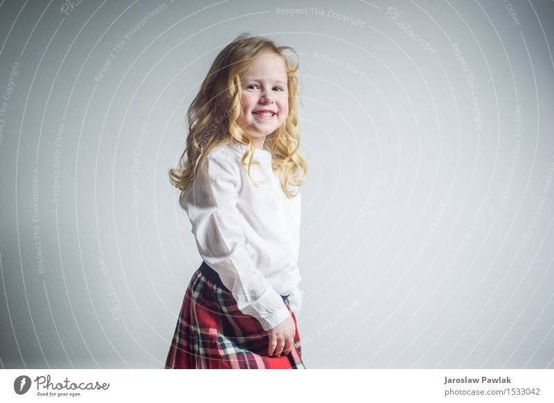 Beautiful smiling blond girl in a school uniform Lifestyle Joy Happy Face Child School Human being Woman Adults Infancy Youth (Young adults) Hand Blonde Smiling
