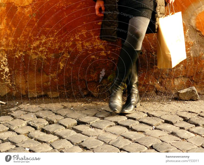 Shopping in Rome Paper bag Dirty Skirt Boots Easygoing Rust Cobblestones Break Lean Woman Thin Beautiful Derelict