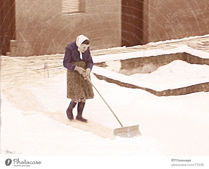 Anna has been cleaning up for 96 years Winter Snow Shovel Woman Adults Grandmother Rubber boots Headscarf Cool (slang) Neighbor Snow shovel broaching