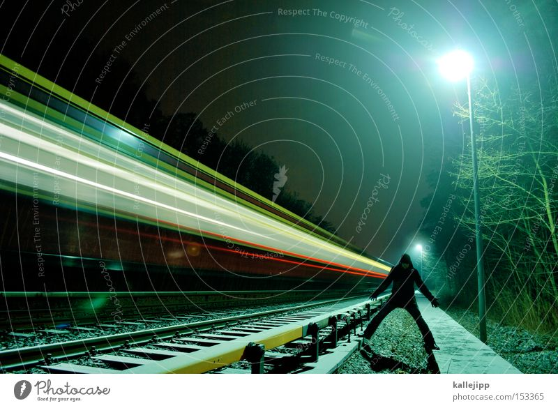 night train Railroad Man Human being Railroad tracks Speed Light Lamp Overnight train Winter Traffic infrastructure Target Arrival Schedule (transport)