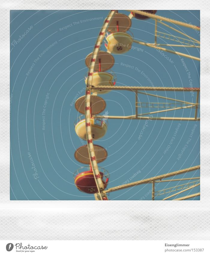 Sky Blue Yellow Leisure and hobbies Fairs & Carnivals Polaroid Partially visible Ferris wheel Theme-park rides