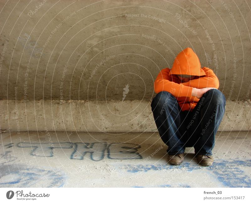 Human being Loneliness Cold Sadness Orange Poverty Concrete Sit Grief Bridge Distress Anonymous Tramp Hooded (clothing) Interlock Interlocked