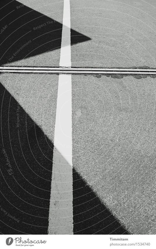 It's a motive thing. Traffic infrastructure Line Esthetic Sharp-edged Gray Black White Asphalt Seam Triangle Perspective Black & white photo Exterior shot