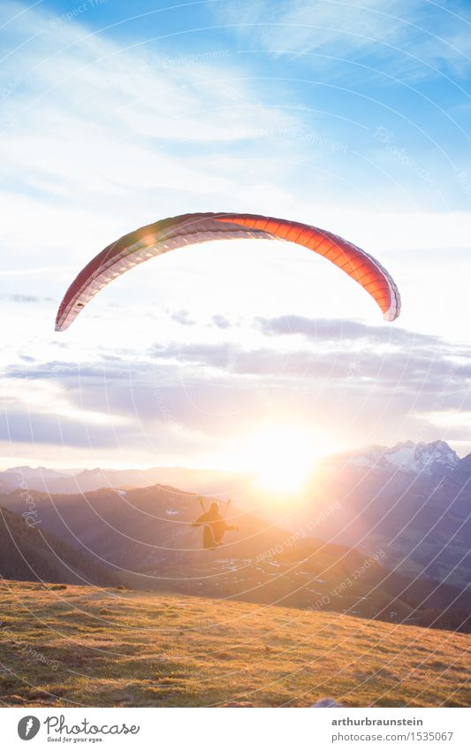 Paraglider at sunrise Lifestyle Joy Athletic Leisure and hobbies Parachute Trip Freedom Mountain Sports Paragliding Human being Masculine Feminine Young woman