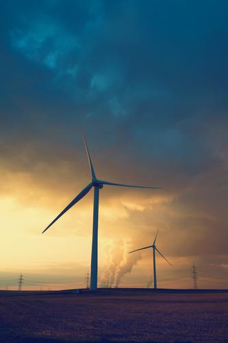 Focus on energy system transformation Energy industry Renewable energy Wind energy plant Coal power station Sky Clouds Sunrise Sunset Field Work and employment
