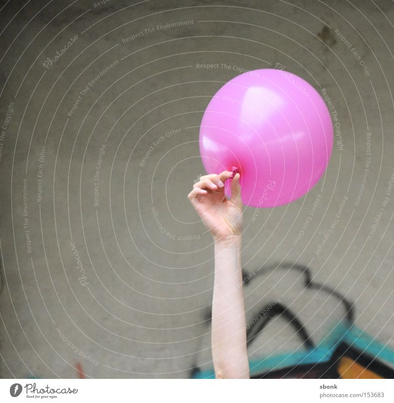 Hand Playing Air Pink Concrete Balloon Inflated Effortless