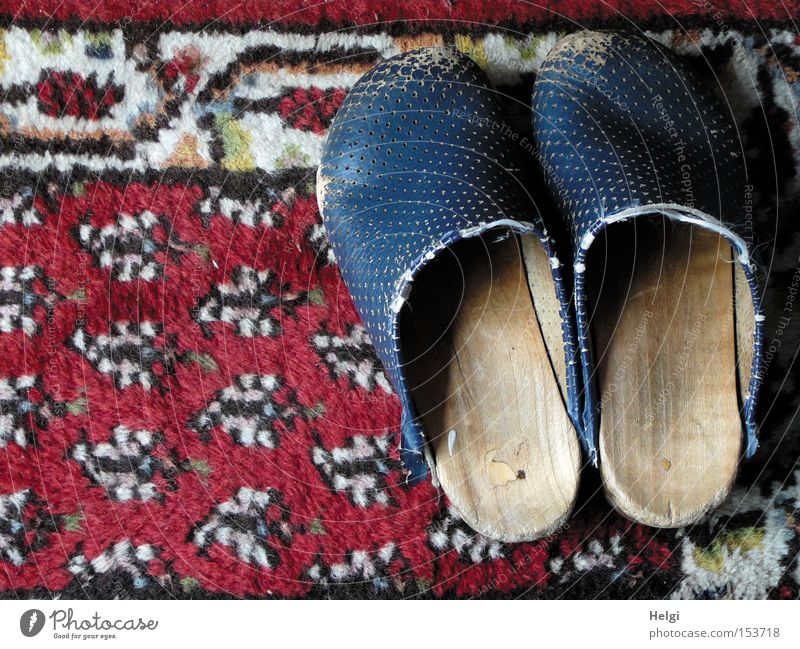 Old White Blue Red Wood Footwear Clothing In pairs Broken Obscure Shabby Leather Carpet Floor covering Worn out