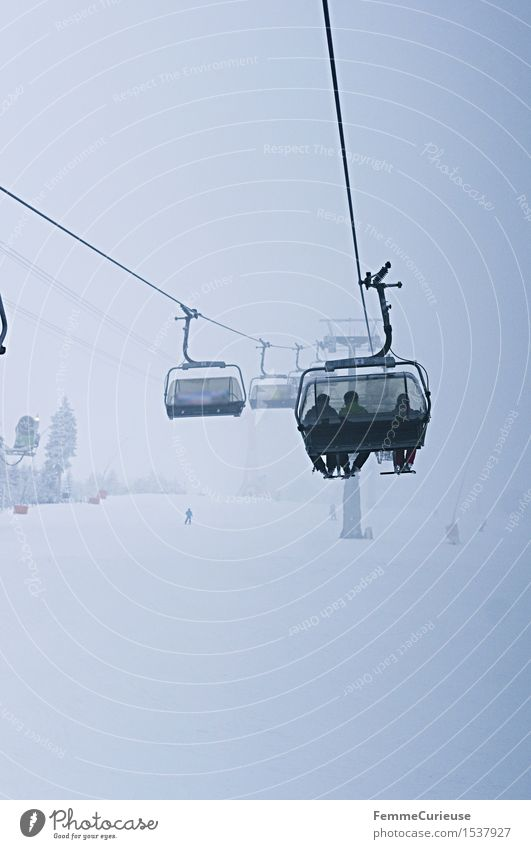 SnowDays_03 Winter sports Adventure Winter vacation Skilift chair Ski lift Ski resort Cable car Mountain Erz Mountains fichtelberg Blue tone Fog Rear view
