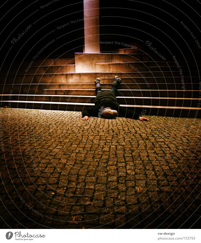 Human being Man Youth (Young adults) Death Sleep Stairs Lie Sidewalk Boredom Traffic infrastructure Doll Accident Disaster Toys Flare Cone of light