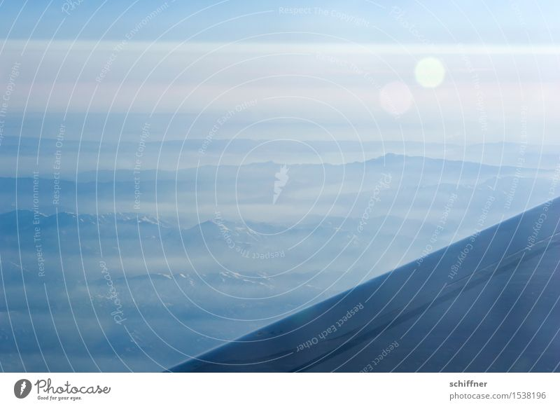 giant chain corner Environment Landscape Sunlight Beautiful weather Mountain Blue Peak Airplane Wing Near and Middle East Background picture Haze Fog Clouds