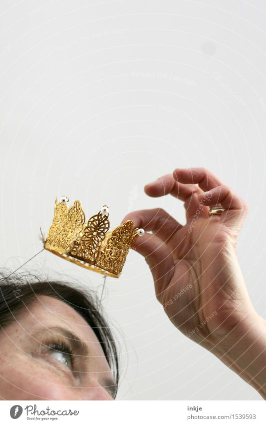 Allow me, Princess. Lifestyle Joy Leisure and hobbies Entertainment Party Feasts & Celebrations Carnival Woman Adults Face Hand 1 Human being Crown Gold Plastic